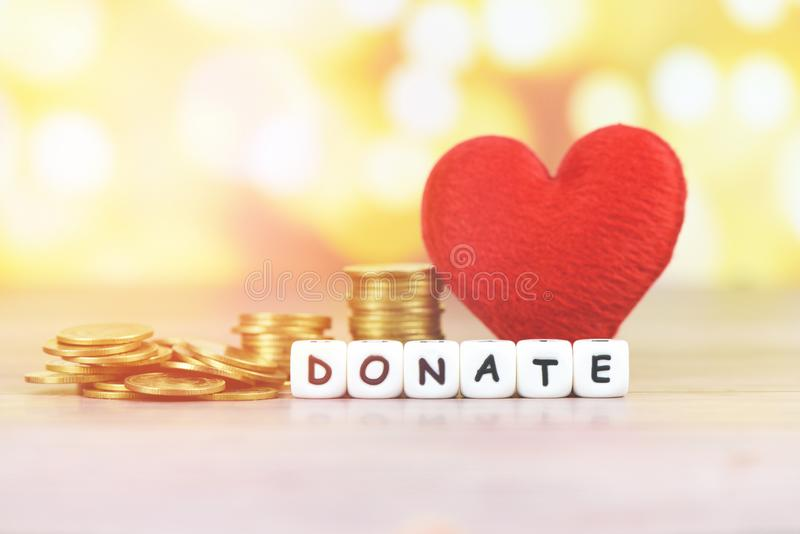 Money saving with red heart for donate and philanthropy / health care love organ donation family insurance and CSR concept world stock image