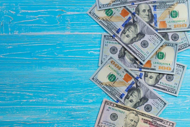 Money scattered randomly. On aquamarine wood board stock photos