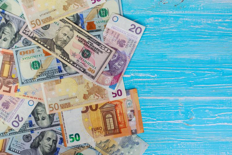 Money scattered randomly. On aquamarine wood board royalty free stock photography
