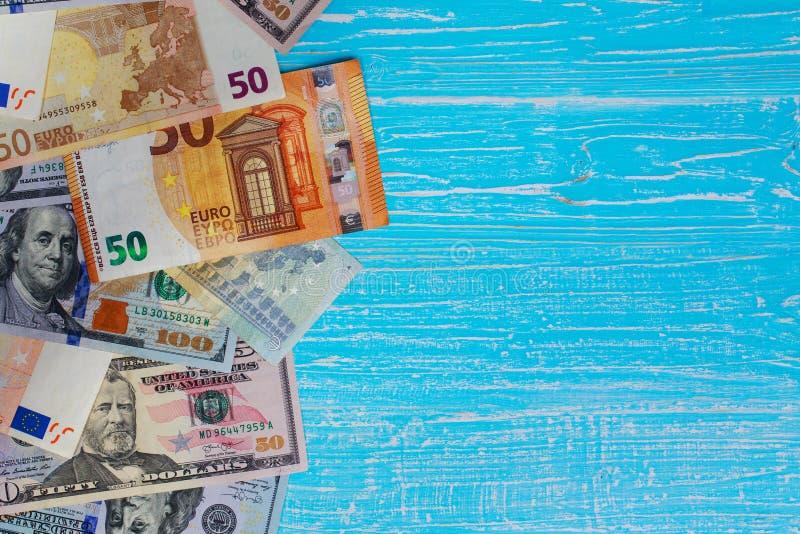 Money scattered randomly. On aquamarine wood board royalty free stock image