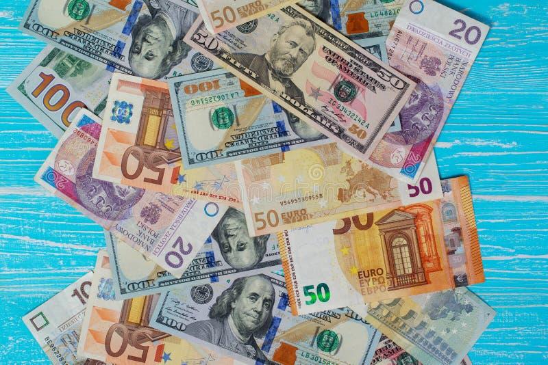 Money scattered randomly. On aquamarine wood board royalty free stock photo