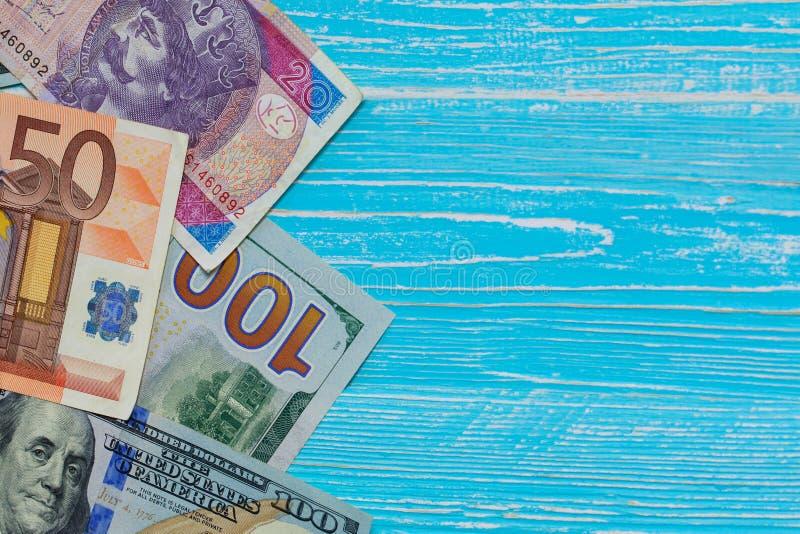 Money scattered randomly. On aquamarine wood board stock images