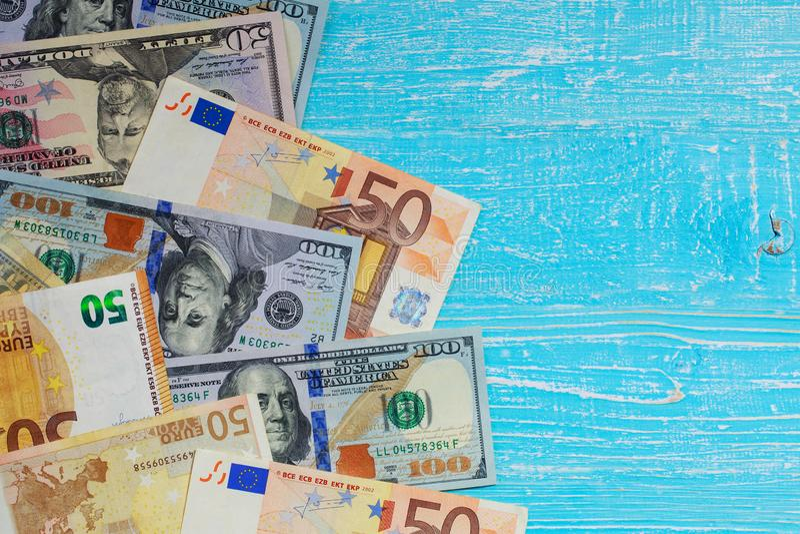 Money scattered randomly. On aquamarine wood board stock photo