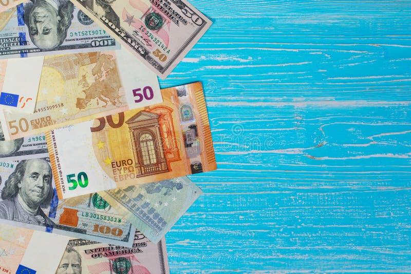 Money scattered randomly. On aquamarine wood board stock photography
