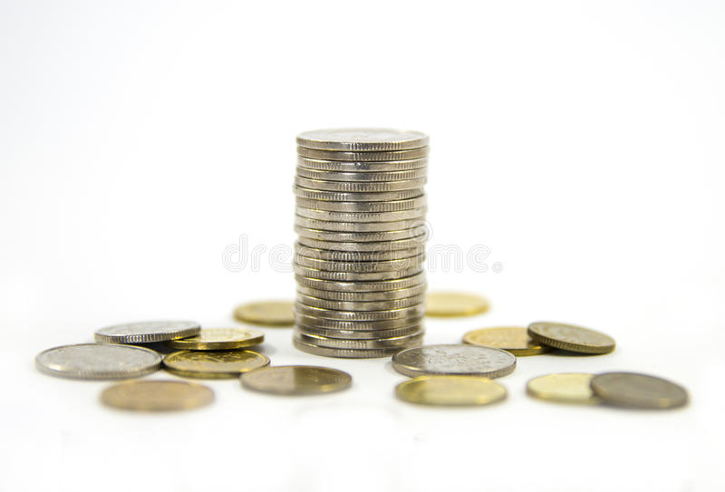 Money, stack of coins on white background. Saving money concept. Growing business. Confidence in the future. Quiet life stock photography