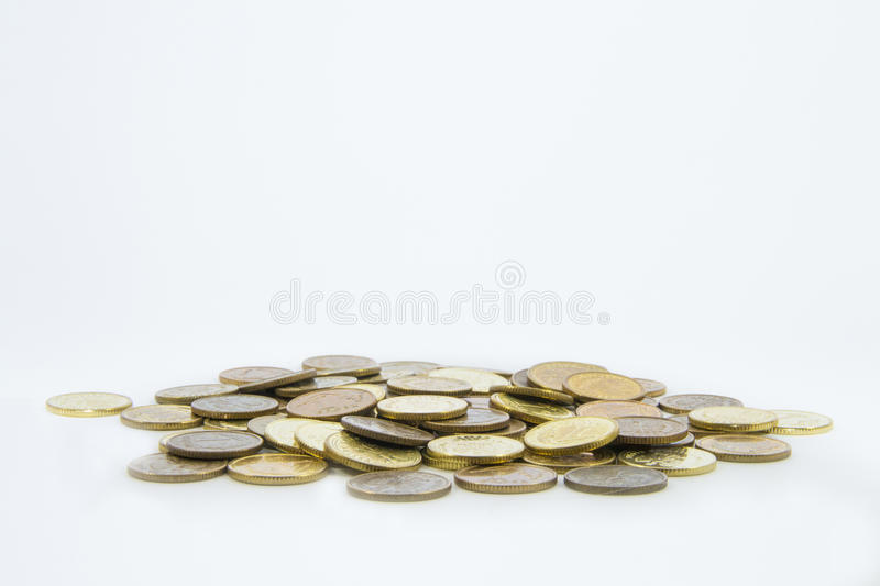 Money, stack of coins on white background. Saving money concept. Growing business. Confidence in the future. Quiet life royalty free stock photography