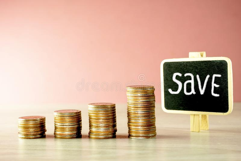 Money stack on wooden with save word. On black board about financial pink background stock photography