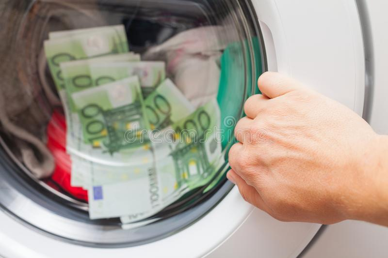 Money stuck in the washing machine stock image