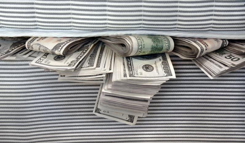 Download Money Stuffed In Between The Mattresses Stock Image - Image: 7053895