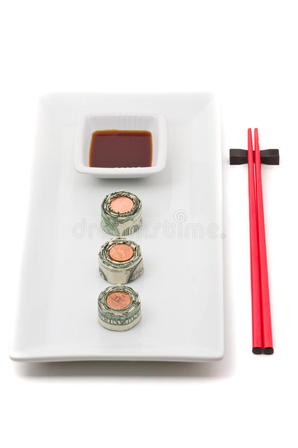 Money sushi. Plate of sushi made from money over white background royalty free stock images