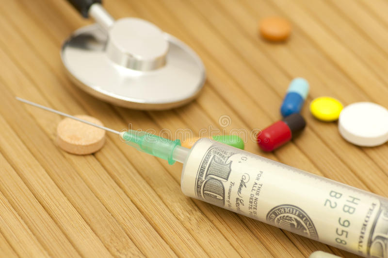 Money in syringe stock photography