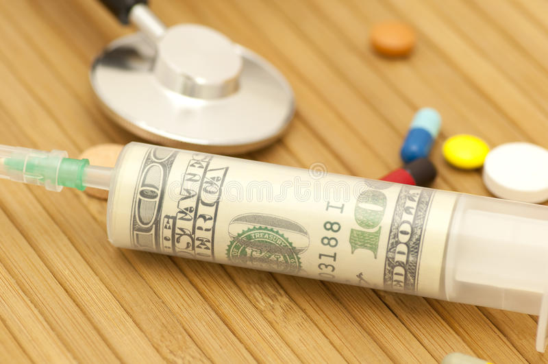 Money in syringe royalty free stock image