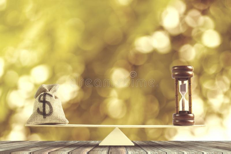 Money and Time balance, Change money into cash or reverse concept : US Dollar in sack bag, Hourglass put on scales on wood table stock photos