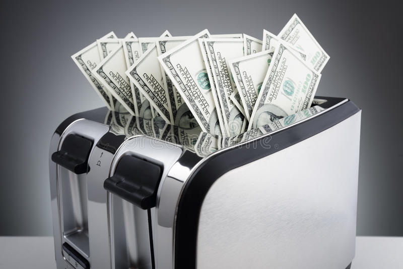 Money to burn stock photos