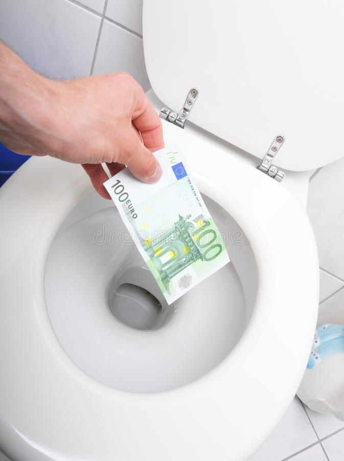 Money and toilet. Showing financial crisis concept royalty free stock photo