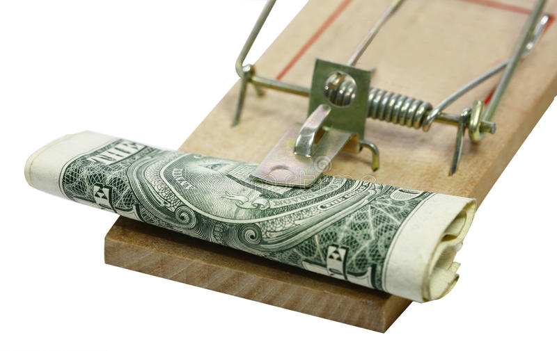 Money and trap. A roll of paper money and a mouse trap stock photography