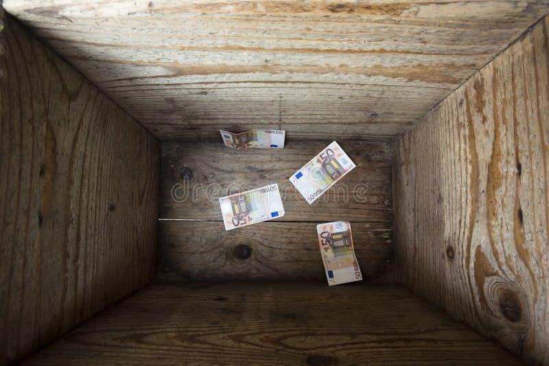 Money trap. Four 50 euros bills inside a wooden box. Money trap concept stock image