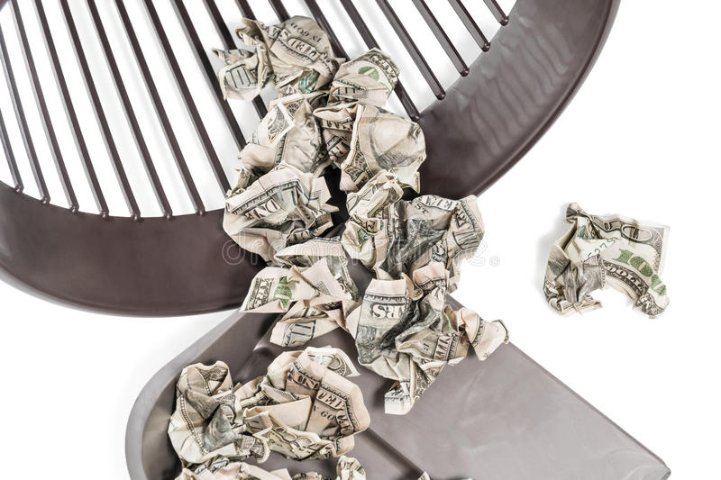 Money in a trash can and bucket royalty free stock image