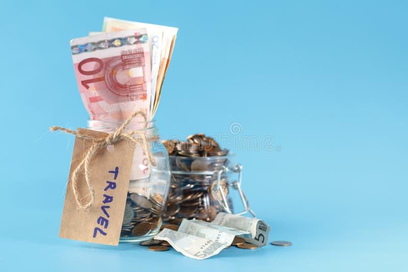Travel jar - vacation savings stock image