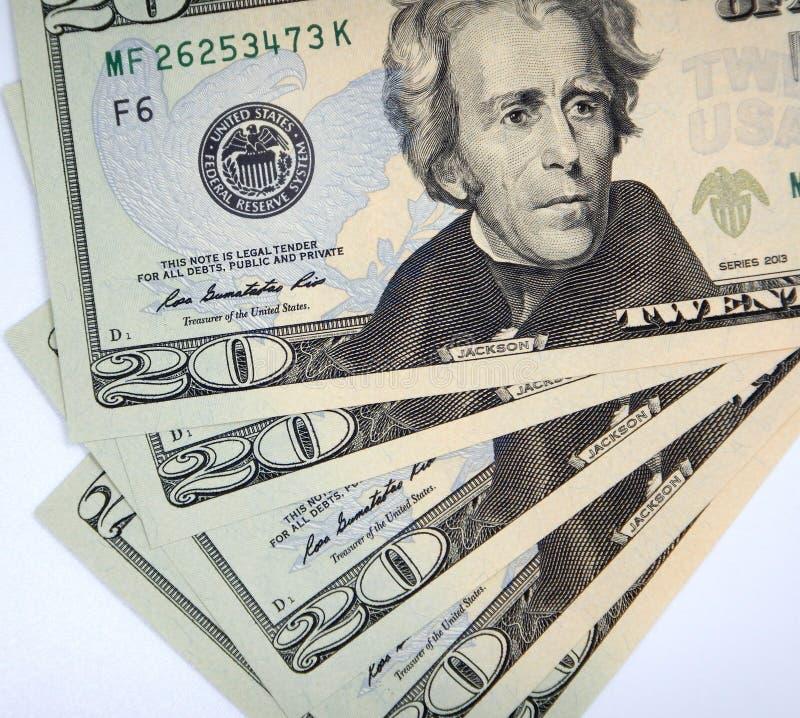 Money, twenty dollar banknotes on a white background stock photography