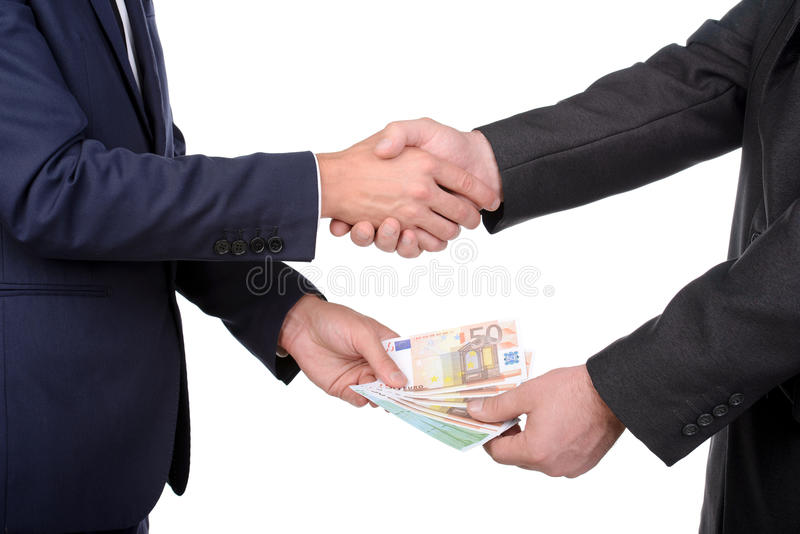 Money. Two businessmen and paying money, isolated on white royalty free stock image