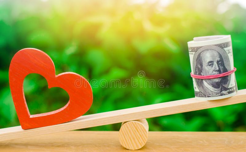 Money versus love concept. Passion versus profit. Family or career choice. family psychology. place for text. wooden figures of pe. Ople. balance royalty free stock photography