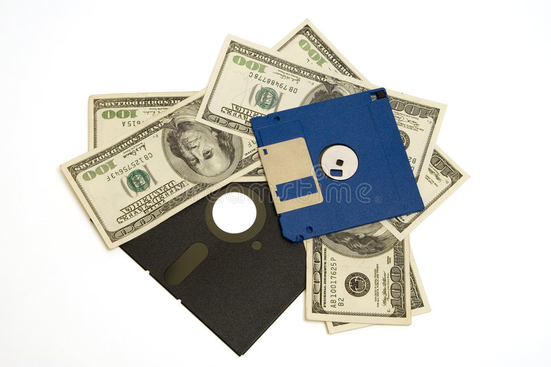 Money waste. Floppy diskettes and 100 dollar bills, representing wasting money on legacy software. Isolated (clipping path stock photo