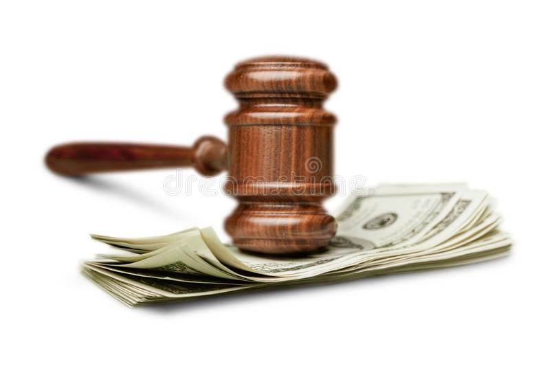 Wooden gavel with money on white table royalty free stock photos