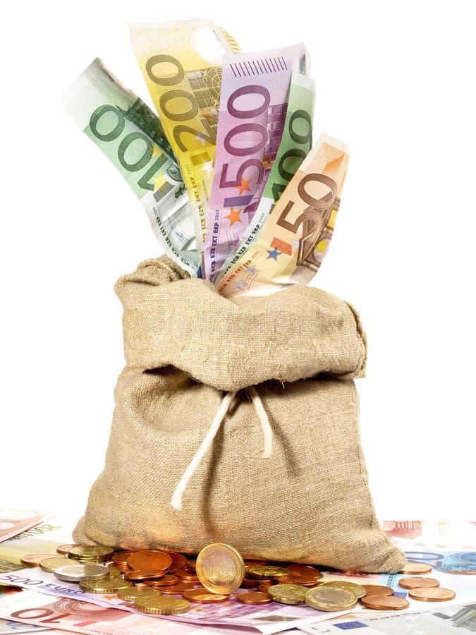 Moneybag avec des billets de banque et des pièces de monnaie photos libres de droits
