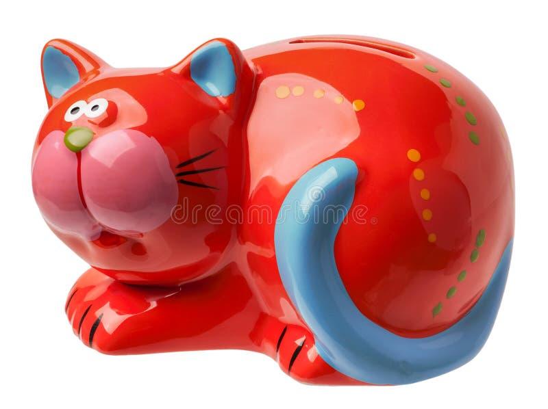 Moneybox bajo la forma de gato rojo imagenes de archivo