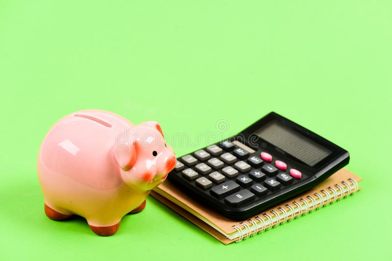 Moneybox with calculator. Piggy bank. bookkeeping. financial report. planning counting budget. Commerece business royalty free stock photo