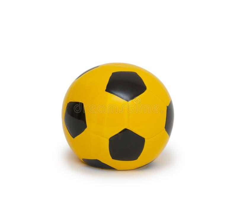Moneybox in Form von dem Ball lizenzfreies stockfoto