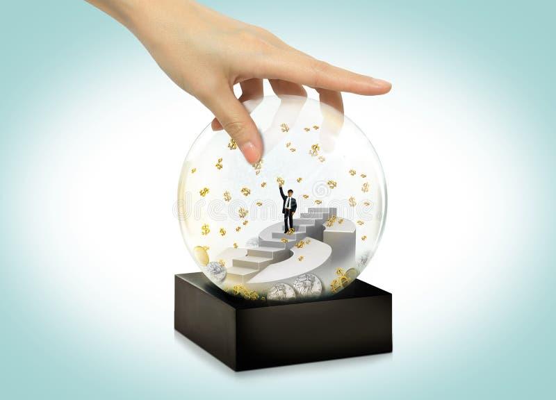 Moneyconcept de la bola de la nieve del negocio imagen de archivo