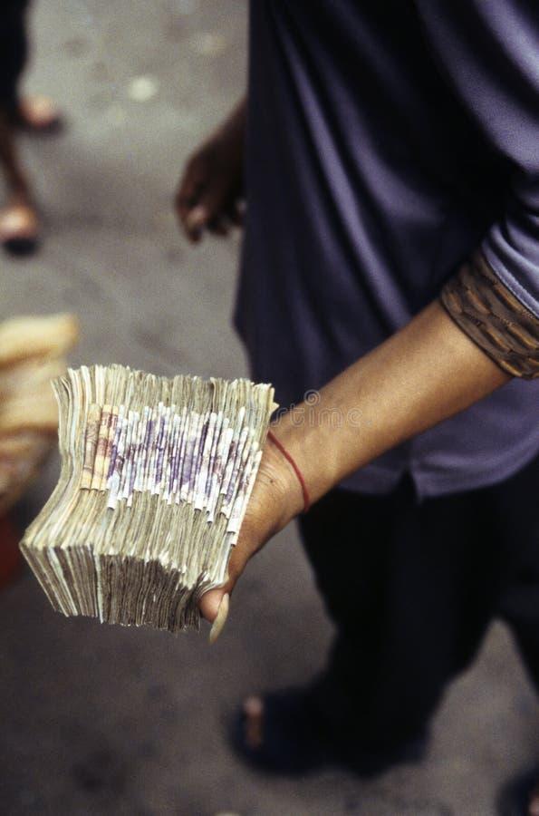 Moneyhandler- Cambodia imagem de stock