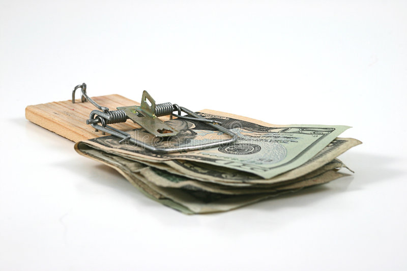 Moneytrap (Money caught in a mouse trap) royalty free stock images