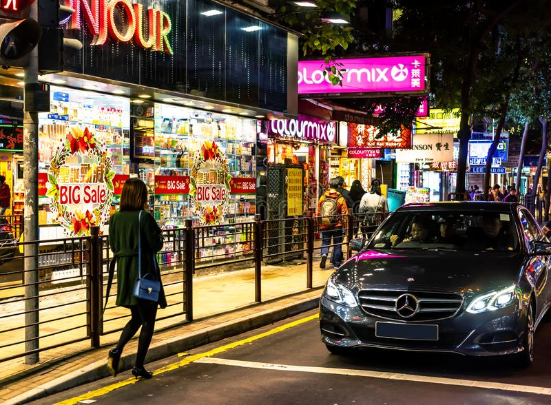 At night, Mong Kok Hong Kong, China. Luxury car cruises of the narrow streets of Mong Kok, Kowloon looking for fun or bargain hunting stock photos