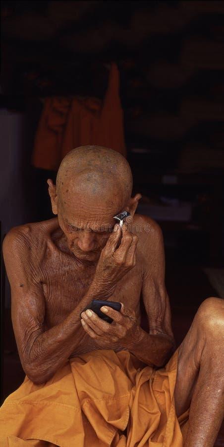 Monge budista em Luang Prabang, Laos foto de stock