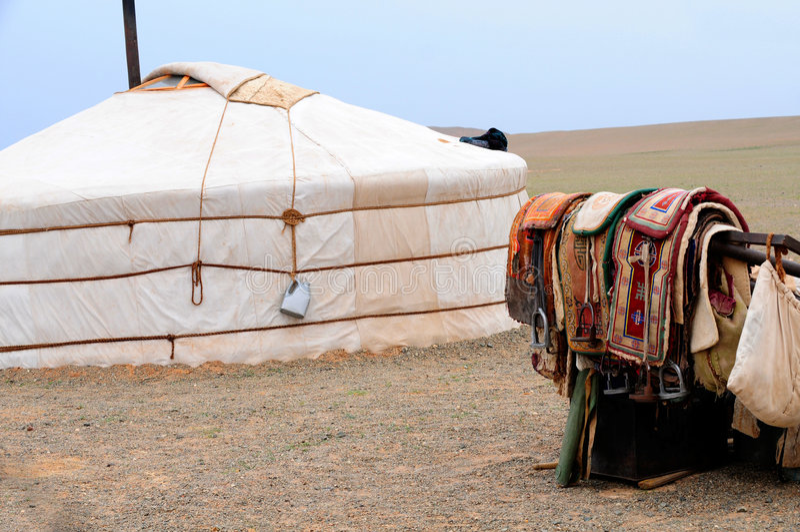 Mongolia – nomad gers (yurt) with horse saddles stock photography