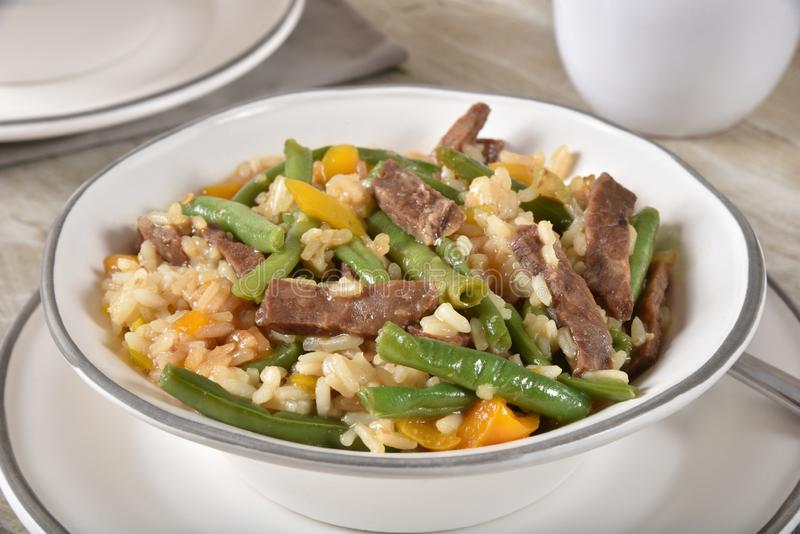 Mongolian beef stir fry. Delicious steaming hot mongolian beef stir fry with green beans, yellow bell peppers and rice stock photo