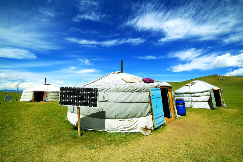 Mongolian ger camps with solar power. TV satellite and oxcart, Central Mongolia. Great contrast, modern and traditional lifestyle melting each other royalty free stock photography
