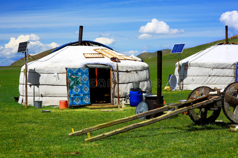 Mongolian ger camps with solar power. TV satellite and oxcart, Central Mongolia. Great contrast, modern and traditional lifestyle melting each other stock photography