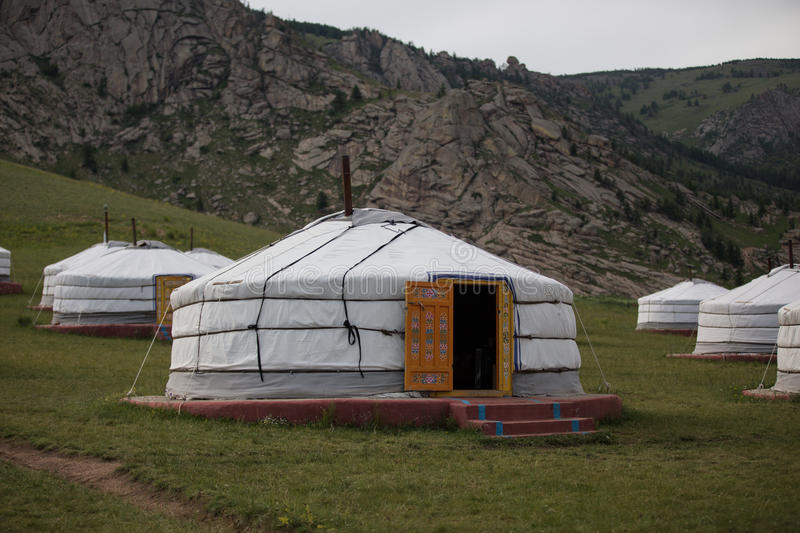 A Mongolian ger in a field. This is the traditional portable home of the Mongolian nomads for hundreds of years royalty free stock photo