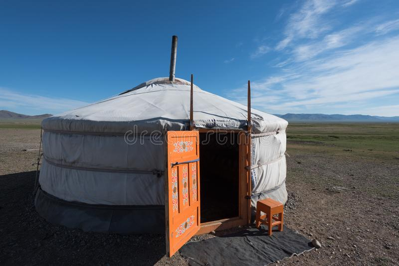 Mongolian ger at its summer location. A ger with orange painted door at its summer location under sunny skies in central Mongolia, Asia stock photos