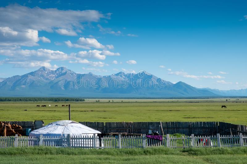 Mongolian ger with mountains. Mongolian ger yurt with mountains in background stock images