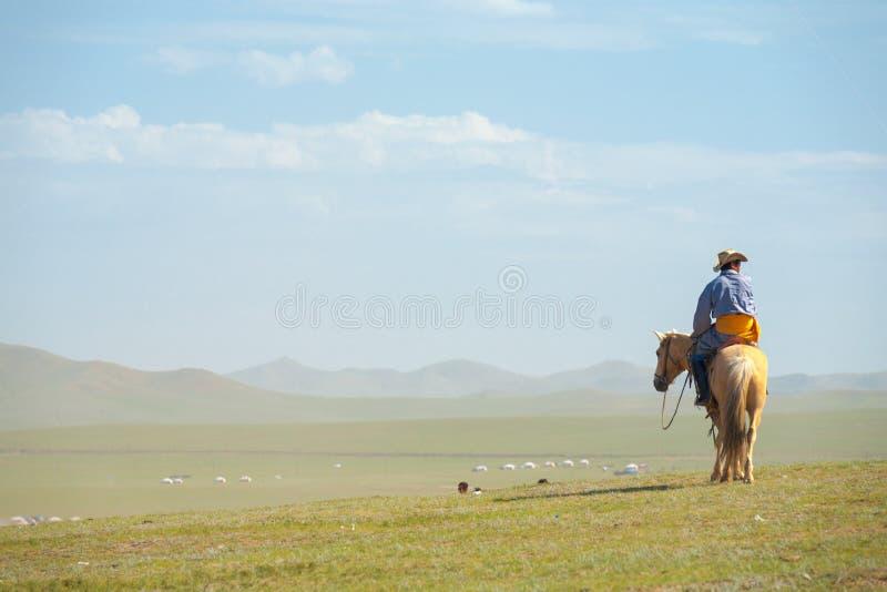 Mongolian Man Horseback Hill View Steppe Mongolia royalty free stock photo