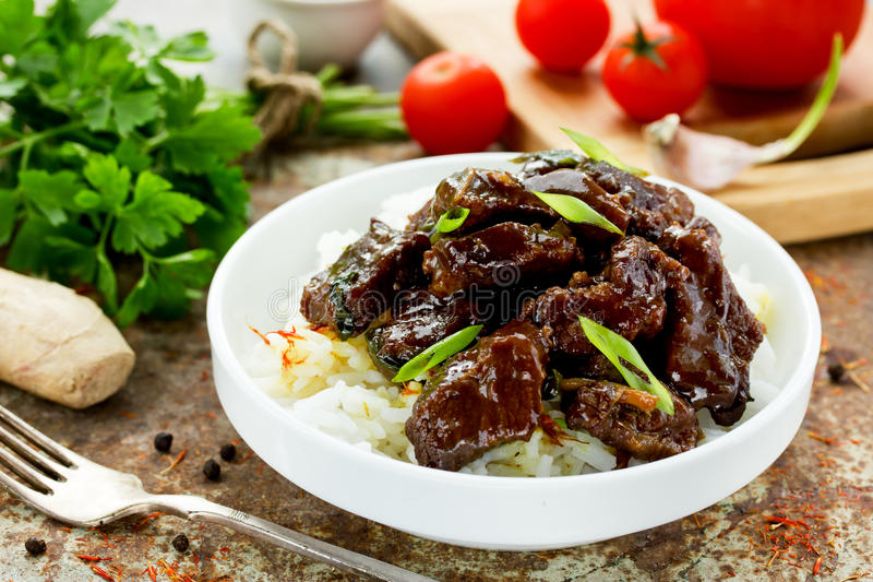 Mongolian meat - beef in sauce with spices stock image