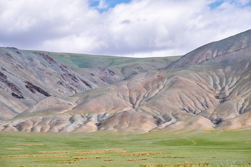 Mongolian mountain natural landscapes with eroded foothill slopes near lake Tolbo-Nuur in north Mongolia stock images