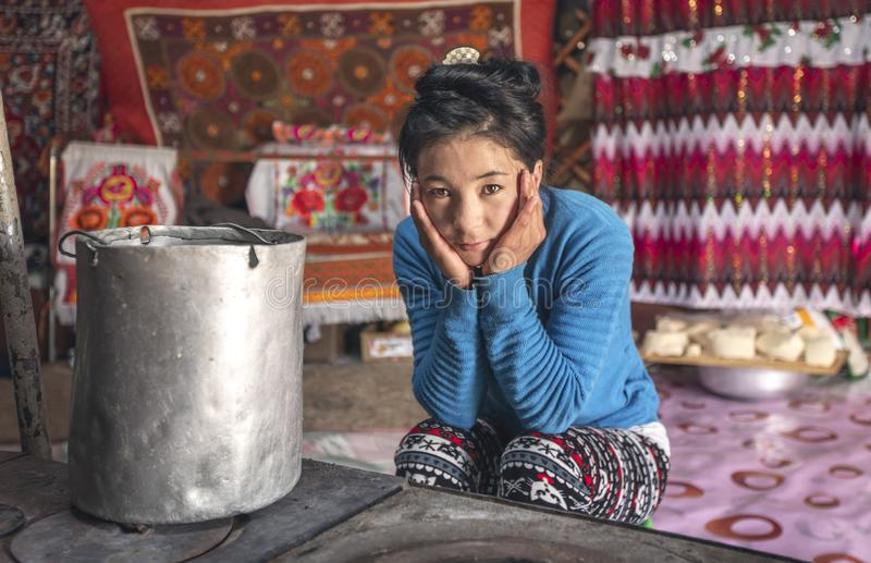 Mongolian nomad woman in her home yurt stock images