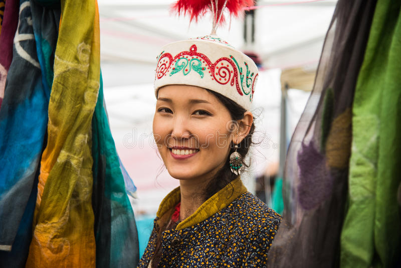 A mongolian woman selling silks and handcrafts from Mongolia. She was working as volunteer in the 4th edition of the United Nation stock images