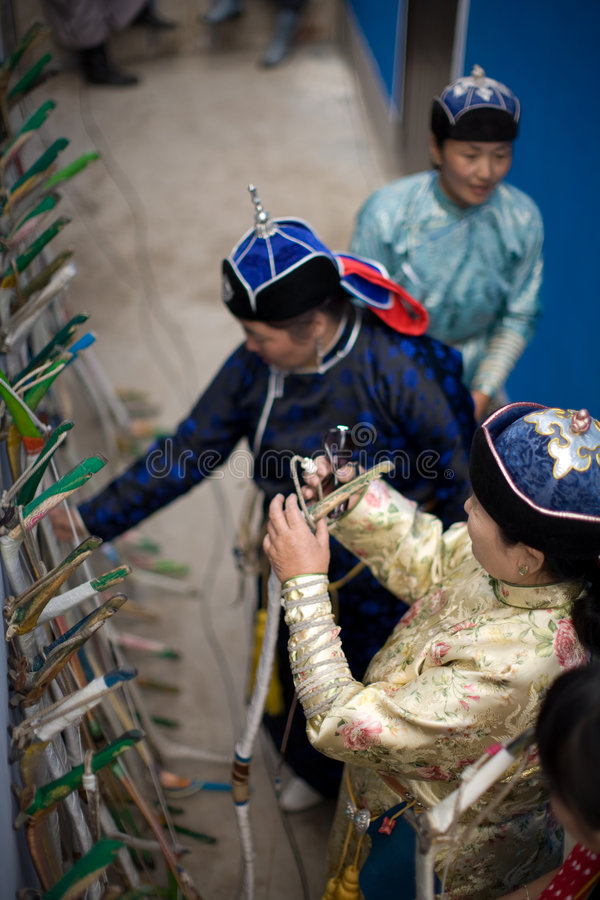 Mongolian Women in archery competition stock photography